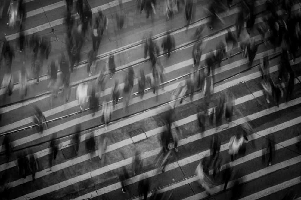 time lapse photography of people walking on pedestrian lane
